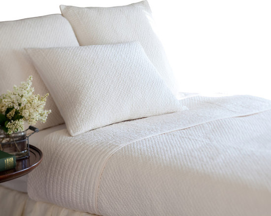 Taylor Linens - Grace Ivory Throw Quilt - Simplicity is the ultimate sophistication — so said Leonardo da Vinci about the Mona Lisa's smile, or a super-soft, hand-stitched 100 percent cotton quilt? You be the judge!