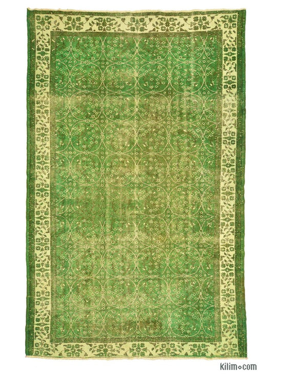 Overdyed Anatolian Vintage Rug - This piece is an Overdyed Anatolian Vintage Rug created by first neutralizing the colors and then over-dying to green to achieve a contemporary effect and bring old hand-made rugs back to life. The result is almost like an abstract painting.