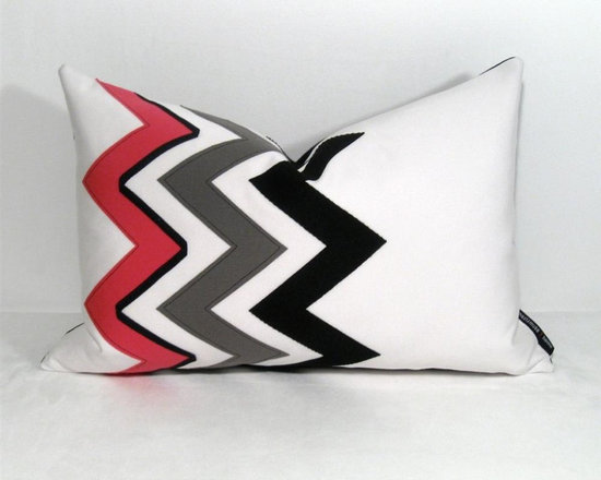 Pink Obliq Outdoor Decor Cushion - This color block pillow features a modern grey black and hot pink zig zag design. Popular chevron pattern is crafted from Sunbrella brand, marine grade outdoor canvas for longevity and lasting design indoors or out! Reverse in black Sunbrella fabric. Fully finished inside with a rugged home decor weight zippered closure.