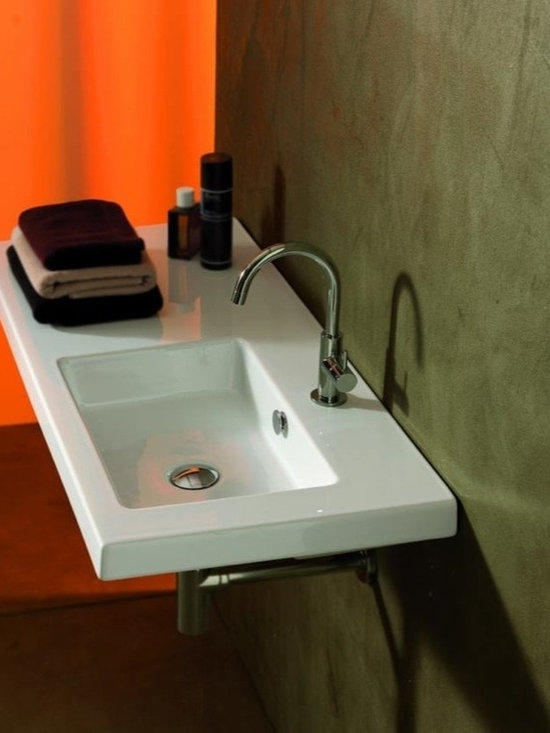 "Tecla - Wall Mounted, Vessel, or Built-In Sink with Left Counter Space - Decorative rectangular bathroom sink made of white ceramic with left-side counter space. Contemporary sink contains overflow and may be purchased with a single faucet hole (as shown), no hole, or 3 holes. Sink may be installed as a wall mounted, above counter vessel, or drop-in sink. Made in Italy by Tecla. Sink dimensions: 39.37"" (width), 17.72"" (depth)"