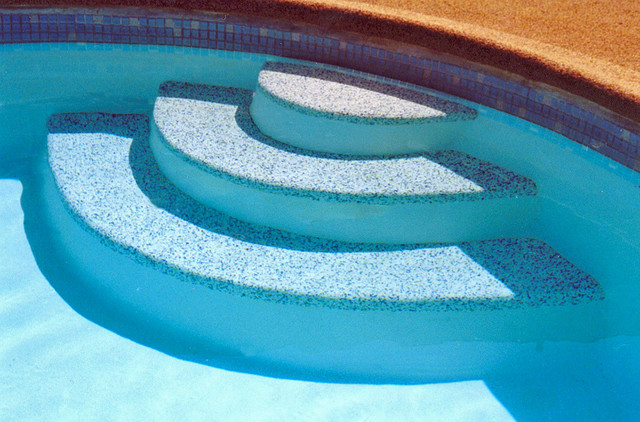 Re surfaced pool steps by rubaroc rubber safety surfacing