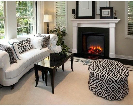 """Heatilator Built-In Series - Traditional has never been this easy. A detailed masonry-style interior, textured log set and 4 flame height adjustments enhance the appeal of these two classic Built-In models. Enjoy the ambiance—with or without the heat. Experience """"Fire Made Simple."""""""