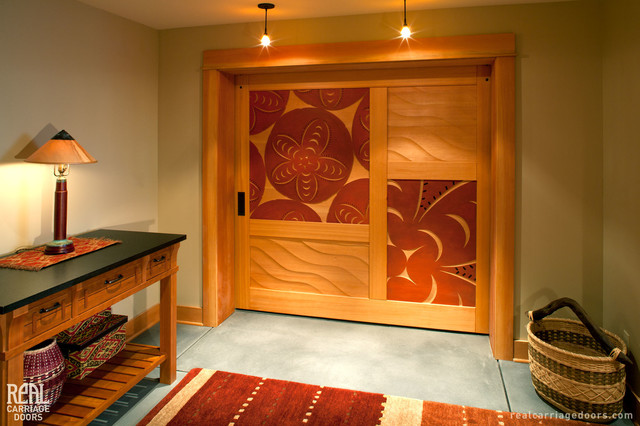 Sliding Barn Door with Art Carvings tropical-living-room