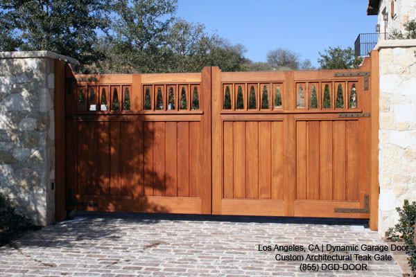 Custom designed solid teak automatic driveway swing gates for How to build a driveway gate