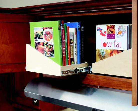 Pull Out Cookbook Shelves - ShelfGenie offers two shelving profiles - our standard shelf and our sloped shelf.  The slope provides more security for taller items stored in the back of each shelf.  When you turn the sloped shelves sideways and install in an upper kitchen cabinet, you have our pull out cookbook solution.  This is a great kitchen idea for people who love to use their cookbooks frequently.  They're easily accessed when needed.