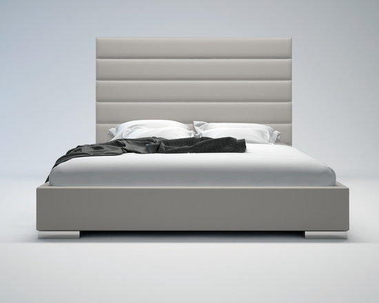 Prince Contemporary & Modern Bed by ModLoft - Adorn your bedroom with the striking Prince bed. Its strong appearance features a tall leather panel-tufted headboard standing five feet tall. Tapered leather side rails and footboard complete the bed, and because of its trim proportions, the Prince can accommodate any limited space rooms. Low profile chrome feet finish its modern appearance perfectly. The mattress sits snuggly atop a solid pine-slat base for stylistic durability and added comfort. Platform height measures 14 inches (2 inch inset). Available in California-King, Standard King, Queen, and Full sizes. Colors available include White and Dusty Grey bonded leathers. Assembly required. Mattress not included. Imported.