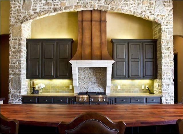 Cantera & Copper Hood mediterranean-kitchen