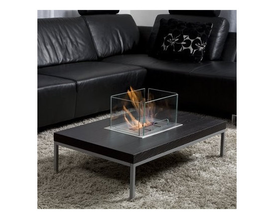 BB-IT24869 - A fireplace as a centerpiece is a touch of magic in smaller spaces.