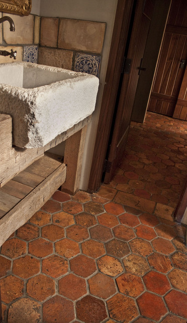 Guesthouse with reclaimed French Terracotta Flooring and Shower mediterranean-bathroom