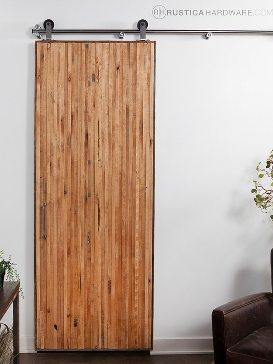 Vertical Rip Top Barn Door - Characterized by tall, perpendicular lines, this Vertical Rip Top door communicates a sense of height. Rustica's Rip Tops are a proprietary design using 100% recycled solid knotty alder wood strips that would otherwise be thrown away. This unique barn door is made from a beautiful composition of staggered wood strips at different heights and sizes. Each vertically aligned panel is a reclaimed and salvaged piece of art. This is our #1 Designers Choice Barn Door.