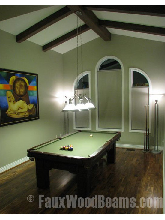 Sandblasted Faux Beams - Using faux beams to enhance the peak of the ceiling makes the room feel bigger despite the relatively small space of this Pool Table room.