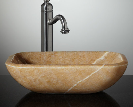 Color - White veining highlights the melon hue of the Eris Honey Onyx Vessel Sink. Carved from stone and polished to perfection, this sink is a one-of-a-kind treasure for your bathroom vanity.--Signature Hardware