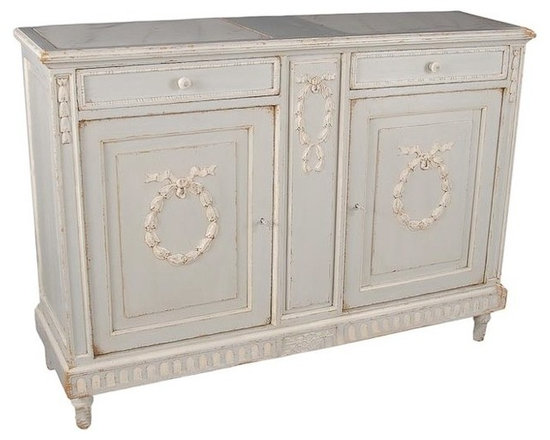 French Laurel Wreath Marble Top Sideboard - Gorgeous sideboard designed from a very special antique.  This solid pine sideboard has a pair of white marble inserts on the top an interior shelf and two drawers. A beautiful hand finished distressed white artisan finish. Charlotte and Ivy loves the laurel wreath carvings on the doors! Made with marble, iron, and solid wood.  MSRP is $4,100