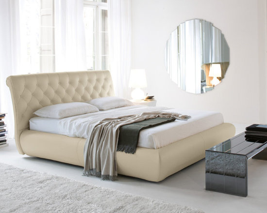Toratelli Bed Frame - Gorgeous hand-tufted genuine leather upholstery with expertly designed style make the Toratelli Modern Leather Bed Frame a favorite.