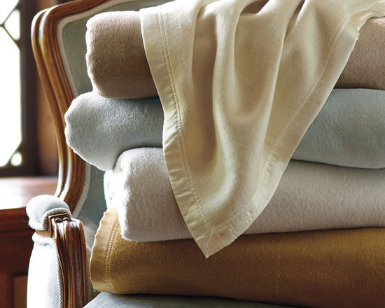 Frontgate - Indulgence Silk Plush Blanket - Made from reclaimed silk remnants. Naturally hypoallergenic. Finished on all four sides with tonal-silk sateen binding. Imported. Our Silk Plush Blanket will feel like an indulgence, yet it's practical for everyday use and an excellent value. Pulled silk is lighter in weight than other silk fibers and lofty like wool, resulting in a blanket that is light and supple. The silk fibers equalize temperature, helping you stay comfortable all night.  .  .  . .