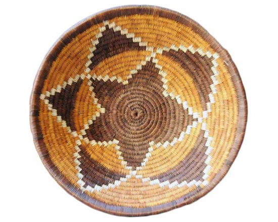 Botswana Delta Basket - Women of the Bayei and Hambukushu tribal groups painstakingly create this art from 'mokola' palm tree fiber coil woven around grass or vine. Traditionally, open bowls are used by women for winnowing grain or carrying things on their heads.