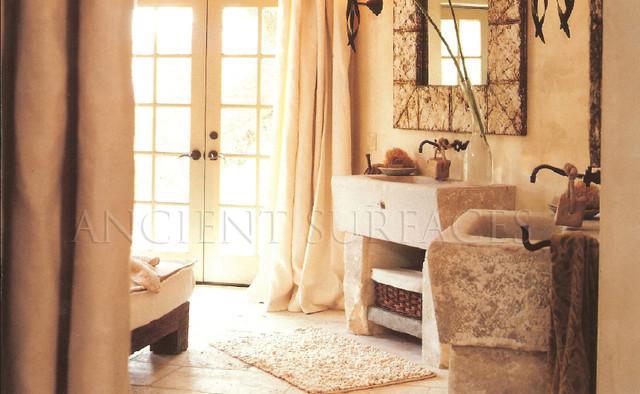 Limestone Wash Basin Sink. 'Lavabeau Neolithique' His and Hers Master Bathroom mediterranean-bathroom-sinks