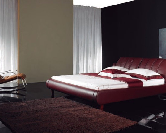 Franco Bed Frame - Rich supple genuine leather upholstery and individually adjustable headrests put a modern twist on this classic styled Franco Leather Bedstead.