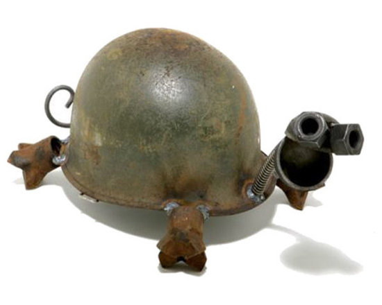 """Helmet Turtle Garden Statue - Inspired by the designers grandfather, who witnessed the attack on Pearl Harbor. """"War happens so suddenly. Peace moves slowly."""" he always said. Upon seeing a sea of army helmets in a surplus yard, these words resonated. Peace moves slowly... like a turtle moves. And thus the first helmet turtle was born."""