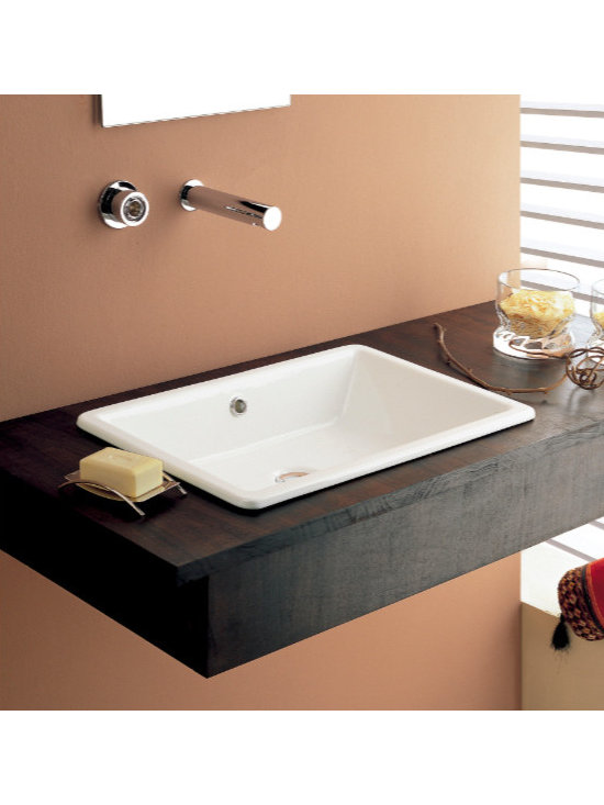"Scarabeo - Wide Rectangular Contemporary Vessel or Built-In Bathroom Sink by Scarabeo - This beautiful wide rectangular bathroom sink is designed and made in Italy by Scarabeo. It is made of high quality white ceramic and includes overflow. The above counter vessel or built-in sink has no faucet holes. Sink dimensions: 22.10"" (width), 15.60"" (depth)"