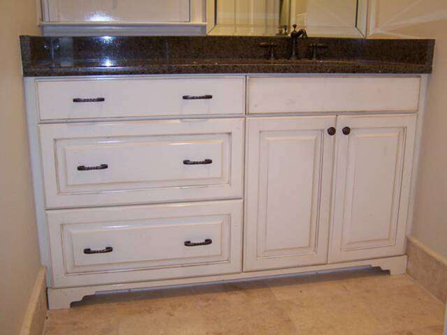 Distressed vanity traditional bathroom vanities and sink consoles jacksonville by for Distressed bathroom vanity cabinets