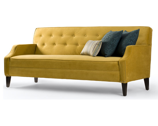 Granger Sofa - With its fitted seat and tufted back, Granger is full of style! It's a very comfortable sofa thanks to the special bench-seat construction. With no loose back or seat cushions, its constantly tidy appearance makes it a great choice for anyone who has a contemporary space and wants to keep it neat and sharp. Shown in mustard-coloured velvet, it's a real showstopper but just incase you would rather something just a little more subtle it's also available in a wide range of fabrics!