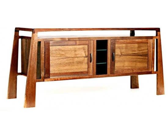 Eco Friendly Furnture and Lighting - An example of how closely we work with clients is the Metropolis Series No.8. When asked to design a totally new cabinet for a summer home in Northern California, The designer set out to create a piece that reflected the rustic surroundings of the home with highlights of modern design elements. Especially unique is the solid top that seems to float as it gently tapers in the middle. The storage unit underneath also has a floating structure design that has it connected at only four points with double floating tennons. Inside each door you will find two adjustable shelves in addition to the middle storage/display section. These design considerations allow the piece to be used as a dinning room addition or a media cabinet. A combination of strong, clean lines and impeccable hand craftsmanship create another timeless design that has a place in many homes.