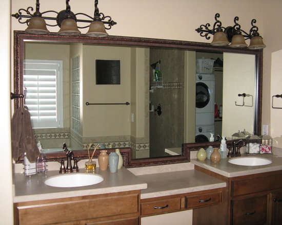 Bathroom Mirror Frame - Reflected Design frames are custom-cut frames that fit any mirror.  They secure right to the surface - so it is no problem if your mirror is up against a wall or back splash.  We accomodate any clips or metal strips holding your mirror up.  Contact us at www.ReflectedDesign.com for samples and to see all before and after pictures.  Over 100 styles to choose from.