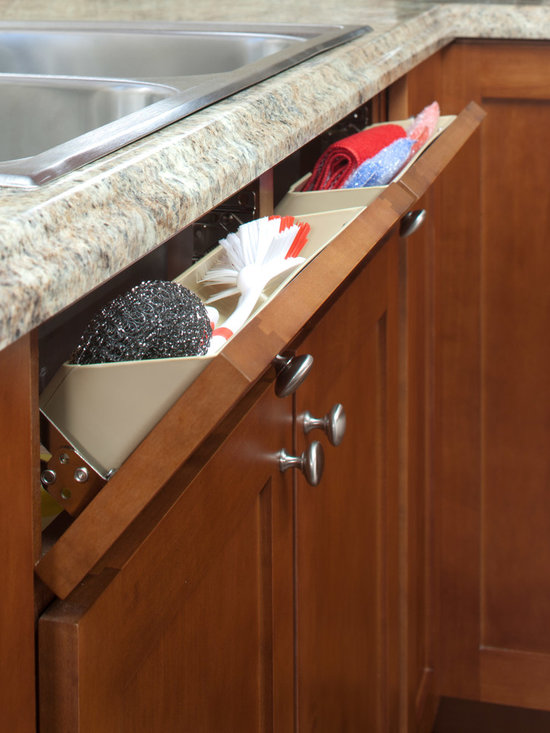 ShelfGenie Tip Out Tray - The tip out tray is the ideal storage spot for your sponges and scrubbing brushes.  Where typically only a false front resides, we install plastic bins and hinge the front.