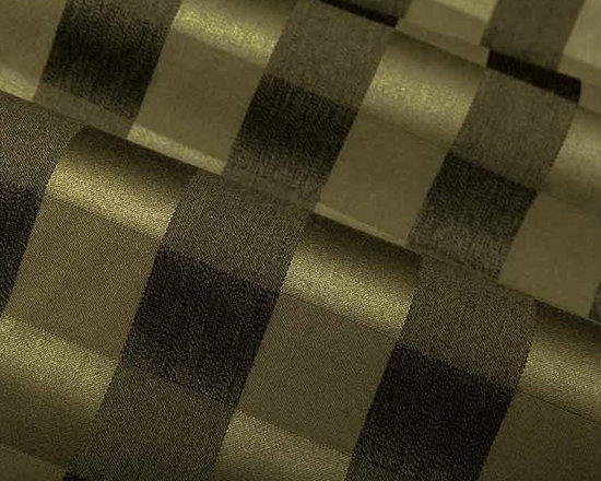 Command Plaid Upholstery Fabric in Olive - Command Plaid Upholstery Fabric in Olive has a dark green and black gingham style plaid pattern that is suave and sophisticated. This heavy duty wool fabric is perfect for high-traffic areas and is now available at a fraction of the retail cost. Made in Great Britain from 100% worsted wool. Exceeds Wyzenbeek 102,000 double rubs. Passes CA Bulletin #117; NFPA 260, UFAC Class I. Cleaning Code: S. Repeat: 3.6″ V 3.6″ H; Width: 54″; 16 oz/linear yd