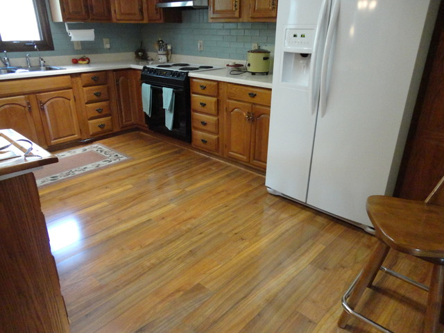 Beautiful laminate floor in kitchen traditional for Laminate floor covering