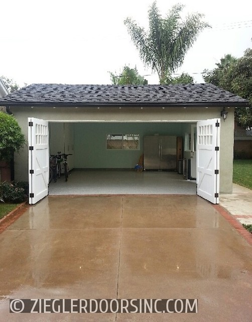 Carriage garage door in a bi fold configuration east side for Farmhouse garage doors