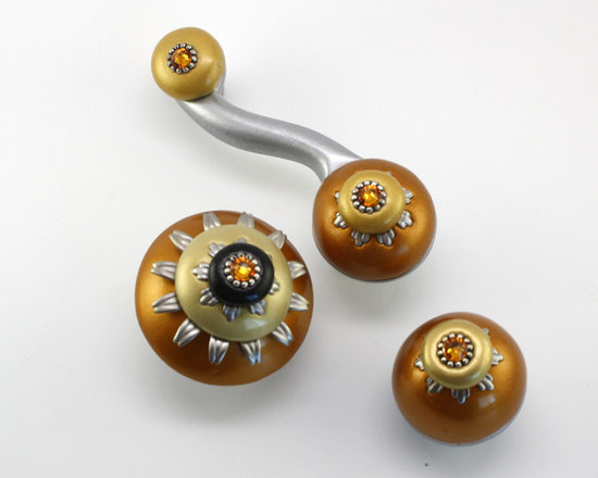 "Susan Goldstick, Inc. - Eel Sunflower Drawer Pull and Knobs - Unique and contemporary, the sunflower collection includes 1.5"" and 2""diameter knobs with matching pulls in 3""  and 4"" hole spans. Paint finish is golden and pale yellow with silver and topaz crystals. Coated with a durable varnish, coordinate knobs and pulls for kitchen and bathrooms."