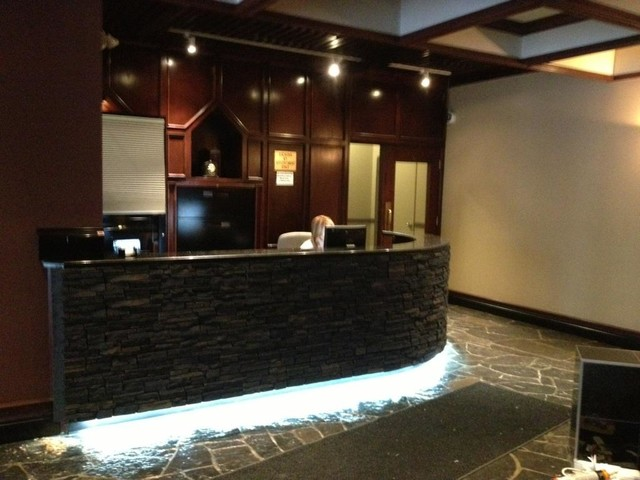 QUALITY STONE CURVED RECEPTION DESK - calgary - by INSTONE PRODUCTS