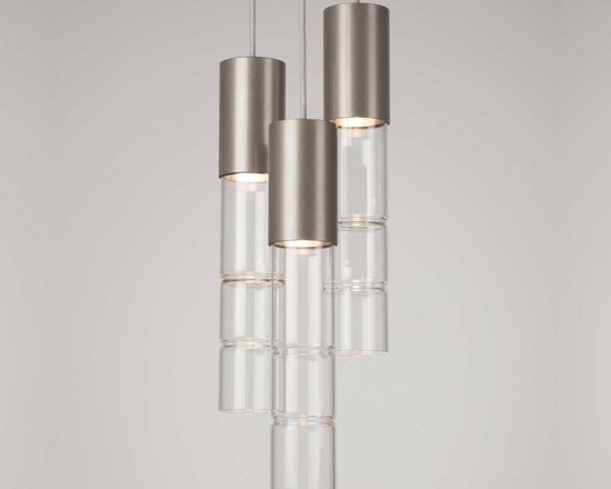 Hammerton - Bamboo Waterfall Suspension - Bamboo Waterfall Suspension is available in a Metallic Beige Silver or Flat Bronze finish with Clear glass. Available in a 3-light and 5-light version. The Bamboo collection pairs sparking smooth columns of fire polished glass with beautifully finished metalwork to achieve a sleek, sophisticated contemporary aesthetic. American artisans carefully hand-form and craft each piece of bamboo glass to achieve its distinctive luminous quality. Our broad selection of Bamboo fixture styles lets you showcase this remarkable look in surprising ways throughout your home. 35 watt 120 volt MR16 medium base halogen lamps are required, but not included. UL listed for dry locations. Dimensions: 3-Light: 9 inch diameter x 14.2 inch shade height x 19 inch minimum to 65 inch maximum overall height. 5-Light: 12 inch diameter x 14.2 inch shade height x 19 inch minimum to 63 inch maximum overall height.
