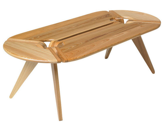 New Breed - New Breed Oval Coffee Table - Something new is brewing. This coffee table features a sculptural design with wedges of solid white oak and tapered legs joined to create a unique mix of solids and open spaces. Finished naturally to show off the wood grain, it's sure to create a buzz in your living or family room.