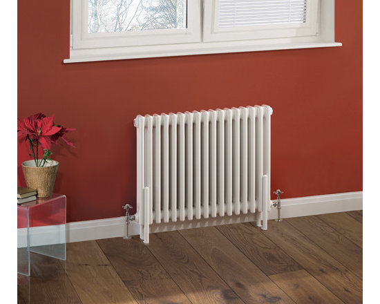 Hudson Reed - Traditional 17 x 3 Column Radiator Cast Iron Style White 23.6 x 31 - This cast iron style radiator, with a high quality white powder coat finish (RAL 9016), has 17 vertical triple columns that give a massive heat output of 1,558 Watts (5,312 BTUs), ample to warm a room quickly and effectively. When combined with a set of modern valves, this up-to-date version of a classic radiator design is an ideal complement to contemporary settings, but also fits in equally well with traditional décor. This versatile radiator is compatible with all domestic central heating systems, will connect with your existing pipe work and is supplied complete with a wall mounting kit. For a truly authentic look, combine this traditional-style radiator with a floor mounting kit (TRUSH017).  Traditional Column Radiator Cast Iron Style White 23.6 x 31 Details  Dimensions: (H x W x D) 23.6 (600mm) x 31 (788mm) x 5 (125mm)   Projection When Fitted: 5.1 (130mm) Pipe Centres: 35 (890mm) Output: 1,558 Watts (5,312 BTUs) Material: Steel Finish: White Powder Coat (RAL 9016) Columns: 17 x 3 Wall Mounting Brackets Included Optional Floor Mounting Kit Available - See Essential Extras Above Please note: Angled Radiator Valves are required, please choose either modern or traditional radiator valves.   5 Year Guarantee on materials and finish  Please Note: Our radiators are designed for forced circulation closed loop systems only. They are not compatible with open loop, gravity hot water or steam systems.