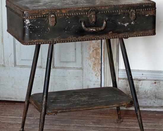 Metal Suitcase Side Table - Not to be outdone by its shelving brethren, this suitcase yearned to be a one of a kind side table. Metal with an extra lower shelf in been-around-the-world distressed black. A home and garden collection selected that bring happy memories of childhood past. Whether you are looking for period charm, a style of elegant restraint or just want to infuse a spirit of playfulness, you'll find it here.