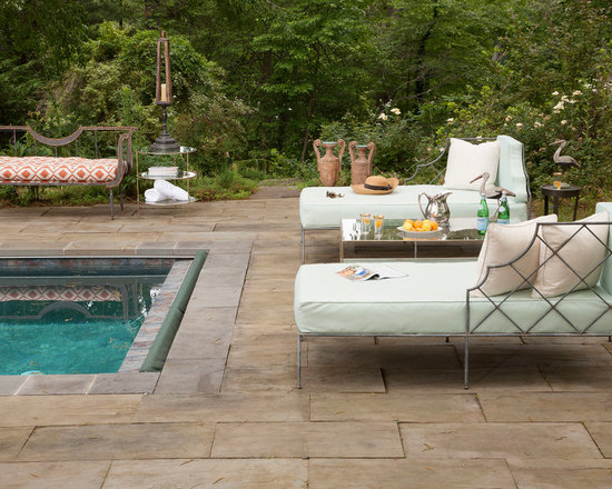 Pool Party Shots - A serene pool setting that features our Melbourne Chaise Lounges, Toulon Settee, Fantome Coffee Table, Roman Side Tables, Fantome Side Table, Amphora Urns and Caribbean Lamp.  Photography by Larry Melton.