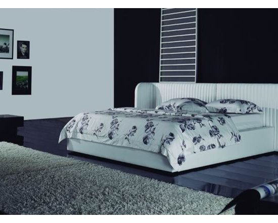 Drake Bed Frame - Ultra high quality genuine leather upholstery with an ultra-hip wrap around headboard design create the perfect addition to your upscale bedroom decor in the Drake Leather Bed Frame.
