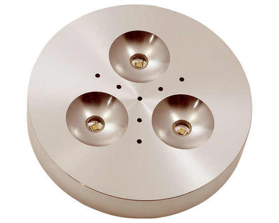 Puck LED Under Cabinet Light - Puck LED under cabinet fixtures provide 3 watts of warm white light and is ideal for under cabinet illumination. Available with a 90 degree beam spread and a 3000K color temperature. Maybe surface mounted or recessed by removing the collar (included). Includes a 36 inch cord/plug port, 3 wire clips and screws. Plugs into 4 or 8 port hub, sold separately, that distributs the low voltage power from a LED power source, sold separately. Compatible with the following hardwire power supplies: TEB-60L-12DC or TE-60L-12(AC), or the following plug-in power supplies: TEB-60L12DC-P or TE-60L-12AC-P (sold separately). Three 1 watt, Cree, 3070K, 84 CRI, LED's included. Providing approximately 50,000 hours life and 138 lumens. Dimmable with a Luton Diva or Skylar low voltage dimmer. Finish available in satin aluminum or white. ETL listed.
