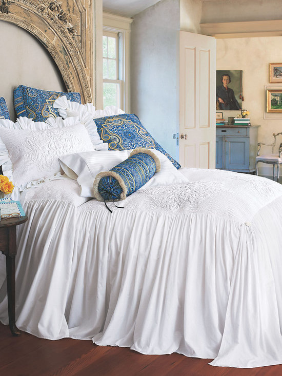 Santorini Skirted Coverlet - Imagine yourself watching the sunset from the balcony of a secluded villa. Re-experience that peaceful bliss each night in your own home with our Santorini Bedding Collection. The exceptionally soft, 100% cotton skirted coverlet features an intricately quilted design created with thousands of hand-guided stitches. The quilting complements the generously gathered, double-layered skirt, finished with corner aprons and accented by pretty rosettes.