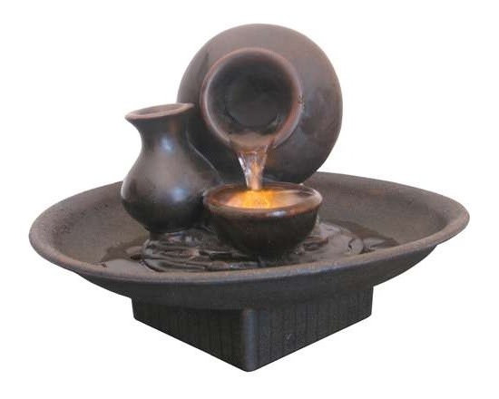 "8"" Pouring Pot Tabletop Fountain - This tabletop fountain features a vessel pouring water into a lighted basin with a second dry vessel at its side.  table top. Includes an underwater LED light illuminating the water flow and a pump. Made of a durable and lightweight poly-resin."