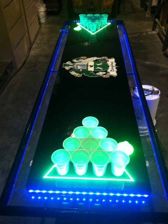 LED Moat Table - The moat table is our top of the line table at Beer Pong Customs. With features like remote operated color changing LEDs, a circulating moat, and automatic ball washers, this table is guaranteed to amaze the party. Whether your new to beer pong or a college student expert, bring out this table and your sure to have a good time.