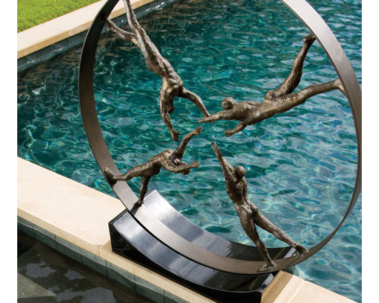 Unity Iron Sculpture - Shipping is included in the price! Unity in mankind is the central theme of this intriguing sculpture.