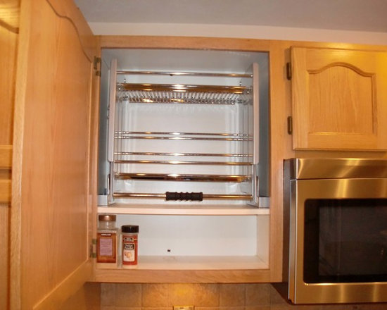 ShelfGenie Pull Down Shelves - Pull down shelves are the ideal way to better utilize upper cabinet space that would otherwise be out of reach.