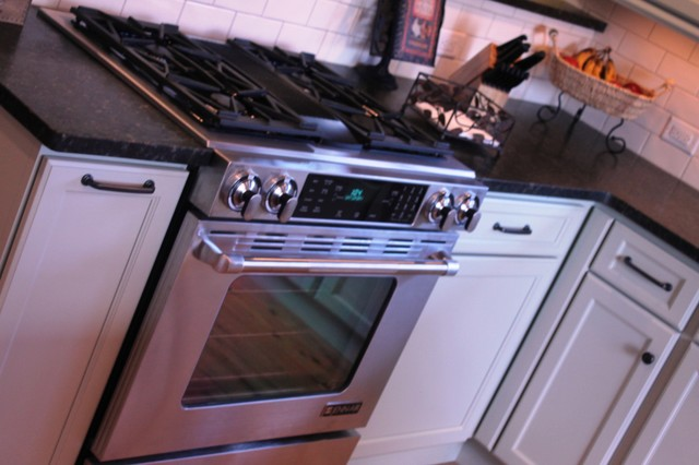Powered by Jenn-Air this downdraft is remotely mounted for quiet operations traditional-kitchen