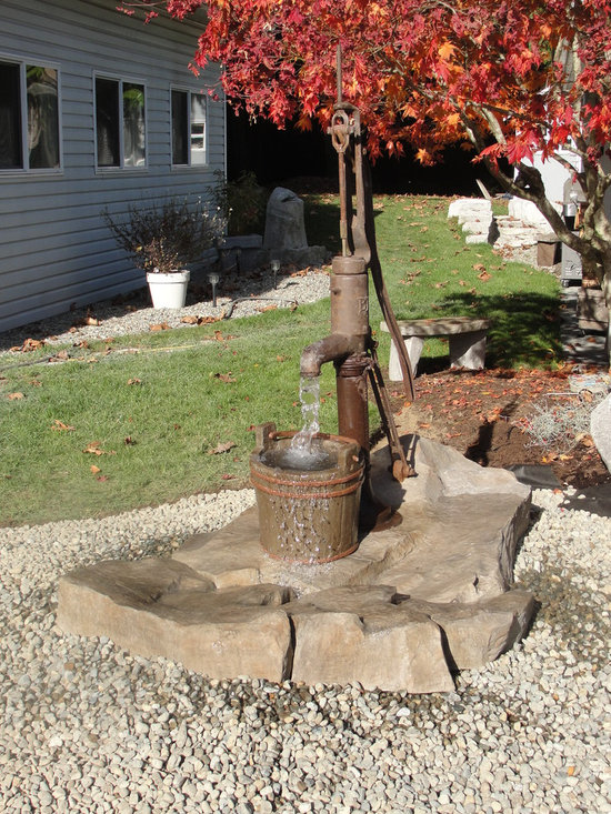 Concrete Water Features - Antique water pump water feature with hand carved concrete bucket and rocks