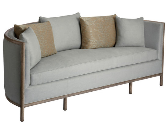 Barbara Barry Lunette Sofa: C-65 - The Lunette Sofa pairs a timeless shape with soft upholstery and elegant rattan. The refined combination brings a quietly grand architectural element to any room. Finished with expert tailoring, one long seat cushion and 5 loose back pillows in 3 sizes, the half-moon rattan armature is an artful gesture; elegant and spare.