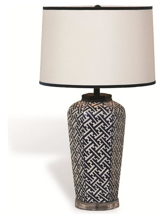 Geo Lamp - We fell in love with a small Japanese sake jar; It was the spark we needed to design our Geo Lamp. The modern geometric pattern of dark navy and white porcelain is joined with a lucite stand. Hardback drum shade with contrasting navy velvet ribbon trim.